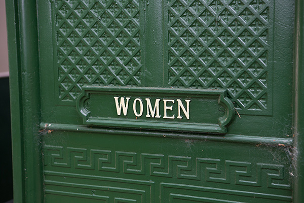 Womens sign on historic toilets